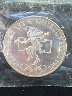 A personal favorite from my Etsy shop https://www.etsy.com/listing/514406671/1968-25-pesos-coin-unidos-mexicanos