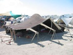 Tips from Burning Man for camping in desert climates. There are tons of cool shots of camp showers, evap ponds, and other stuff not so glorious that isn't normally shown but Really helpful!!!!!!