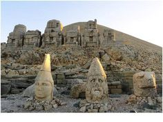 In 62 BC, King Antiochus I Theos of Commagene built on the mountain top a tomb-sanctuary flanked by huge statues 8–9-metre-high (26–30 ft) of himself, two lions, two eagles and various Greek, Armenian, and Iranian gods