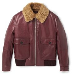 Prada's latest collection is inspired by a nostalgic and melancholic vision of history. Reminiscent of bombers worn by the fighter pilots of World War II, this burgundy leather flight jacket is trimmed and lined in plush shearling. Made in Italy to the brand's exacting standards, it has plenty of pockets, adjustable cuffs and flexible ribbed wool trims that seal in warmth.