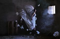 Bride by Ravshaniya.  Check out this photographer at 500 pix.  Truly inspired, very high concept work.