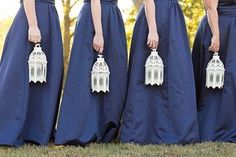 Rather than traditional bouquets, ask your bridesmaids to carry lanterns down the aisle instead!