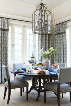 Beautiful dining room, table setting and chandelier combo! #Blue