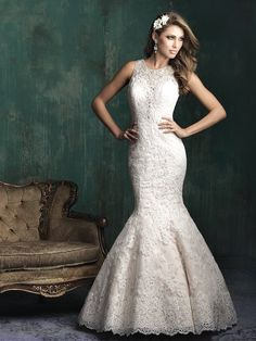 Can you believe the hand beading on this neckline? Dress: Allure Couture 2015
