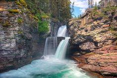 St Mary Falls is easily accessible by a relatively short trail off the…