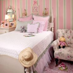 I would love to do this to one of my girls rooms.. I love stipped walls especially if your cieling is not so high!!!