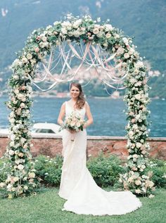 Sweet ribbon draped floral arch: http://www.stylemepretty.com/2015/10/05/romantic-italian-villa-wedding-on-lake-como/ | The Cab Look Foto Lab - http://www.thecablookfotolab.com/