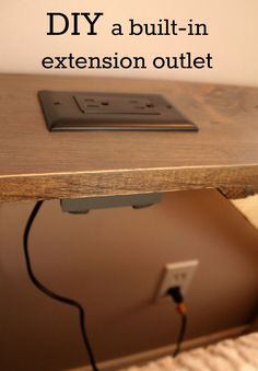 diy desk we converted a wall outlet into an extension outlet for our TV room sofa table. This outlet, built into the face of the table, allows us to utilize the electrical outlet that is behind the couch - without having to move the couch out of the way. Cool Diy Projects, Home Projects, Fall Projects, Furniture Projects, Canapé Diy, Diy Crafts, Creative Crafts, Table Behind Couch, Shelf Behind Couch