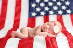 San Diego newborn photographer, newborn baby posing on american flag, military newborn baby pictures, navy newborn baby pictures
