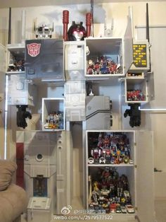 Metroplex Shelving Unit - Transformers Display -- the most awesome way to display Transformers that I've ever seen! (and also the most appropriately sized Metroplex, ever!)