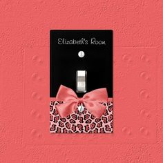 A chic coral pink and black jaguar print light switch cover with a girly cayenne red ribbon tied into a cute bow. Personalize this trendy leopard like animal print home fashion accessory by adding the name of your teen girl.instead of all of that let's make it plain black and make it say Arianna & God