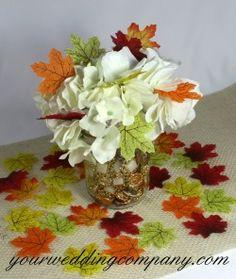 Fall centerpiece idea using mini silk fall leaves.