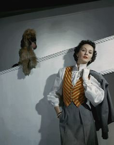 https://flic.kr/p/8NAaPp | 1950 | Model is wearing a wool suit and orange and yellow striped vest by Valentina.  Image by Condé Nast Archive/Corbis