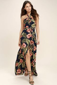 Lulus Exclusive! The Splendorous Navy Blue Floral Print Halter Wrap Dress is our tropical dream come true! Coral pink and green tropical floral print woven poly, starts at a tying halter neck (with elasticized back) and falls to a wrap bodice with tying sash belt. Wrapping detail carries into the high-low maxi skirt.