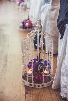 Vintage shabby chic birdcages to line the aisle - Image by Claire Penn Photography - Jenny Packham wedding dress & Harriet Wilde shoes for a classic wedding with bright florals & Coast pastel bridesmaids dresses. Groom wears Marc Wallace suit.