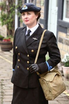 A woman dressed as a WREN (Women's Royal Naval Service) at The 1940s Weekend, held annually in the village of Haworth, West Yorkshire.