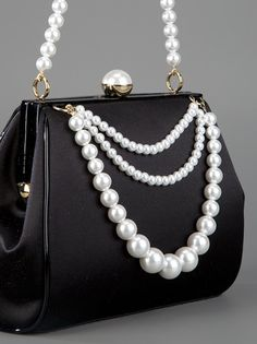 OK this is the last handbag of the night.  This is so very classy.  Just a few pearls on a very simple black handbag.   Moschino black silk and pearl handbag