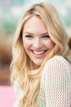 Candice Swanepoel....perfect beach waves and barely there makeup!