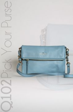 Kate Spade - Krista Crossbody in Blue.   Go to wkrq.com to find out how to play Q102's Pick Your Purse!