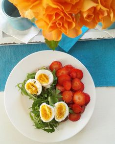 Breakfast ideas. Healthy bread with creams spread, rucolla, boiled eggs and strawberry.
