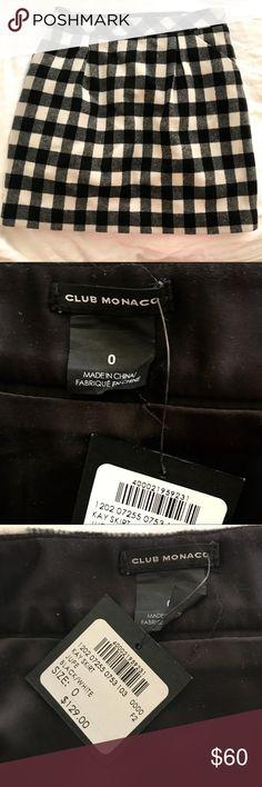 NWT Club Monaco wool checkered skirt NWT Club Monaco black and white wool checkered skirt. Size 0. Perfect for work or play! Club Monaco Skirts