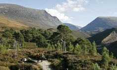 A couple of walkers follow the track from the Lairig Ghru mountain pass in the Cairngorms National Park
