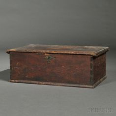 Pine Desk Box, probably Massachusetts, early 18th century, the hinged cleated top opens to a compartmented interior on the dovetail-constructed box, old brass escutcheon, old patina