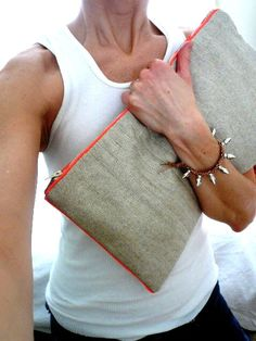 Quilted Zipper Clutch by Olive Brown.  Also - That bracelet!!!