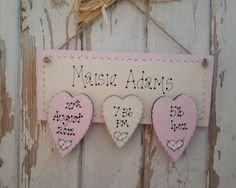 Three Heart Baby Girl Wooden Plaque  Personalised wooden plaque keepsake that is sure to be treasured forever. This personalised baby gift comes painted and varnished and personalised with the baby name on the main wooden plaque and an image of baby on middle heart.