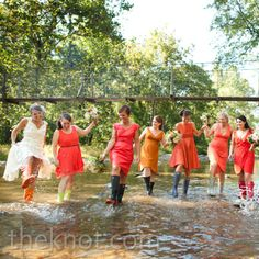 A very fun bridesmaid moment playing in the river // Cramer Photo // http://www.theknot.com/weddings/album/a-farm-fresh-wedding-in-criglersville-va-101649