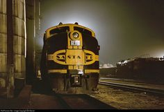 es44c4: Late at night was a good time to visit Colorado & Southern's Rice yard in Denver the late 1950s. You could set up your tripod out of the way of working railroaders. There was usually one of the road's own 2-8-0's shuffling cars and a set of Santa Fe units in from La Junta. On this March evening in 1959 it's a set of FTs headed by the 105, a 1942 EMC product. These were the diesels that drove steam from the rails, a victory symbolized here by the cold, lifeless Burlington 2-8-2 s...