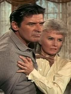 """Peter Breck and Barbara Stanwyck on the tv show """"The Big Valley"""".  Momma holding son Nick back from beating the crap out of a jerk."""