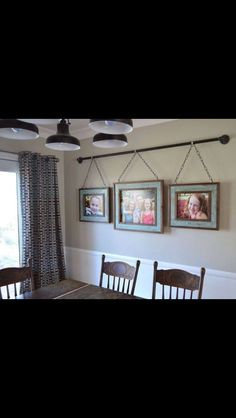 Picture Frames hanging from a rod                                                                                                                                                      Mais