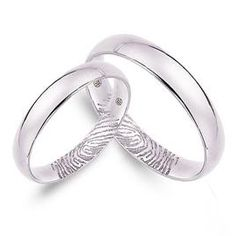 LOVE this idea! Personalized Finger Print SS Wedding Rings, $146.00
