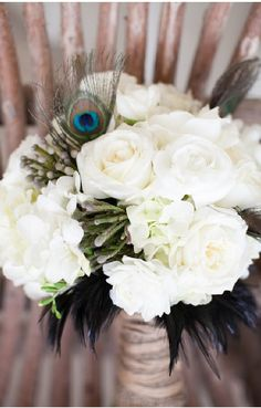Peacock Wedding Bouquet White Roses and Feathers.
