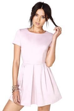 The cutest lilac fit and flare dress featuring pleated detailing and pockets at front. Zip closur...