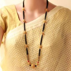 Long Fancy New Design Mangalsutra With matte polish beads and 6 lines small black beads Mangalsutra Simple, Diamond Mangalsutra, Gold Mangalsutra Designs, Egyptian Jewelry, Indian Jewelry, Beaded Jewelry, Beaded Necklace, Gold Jewellery, Jewelery