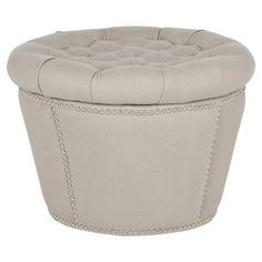 Perfect for stowing extra throws and fashion magazines, this tufted storage ottoman showcases taupe-hued upholstery and nailhead trim. Pr...