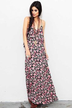 209.00 The Blu Moon Summer Lovin' Maxi Dress in Black Rose Crepe is a bohemian must-have. Constructed from 100% rayon, this dress features a wide V neck and a plunging V back with an asymmetrical ruffle