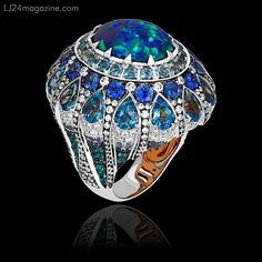 Black opal from Lightening Ridge Australia set with diamonds, sapphires, topaz and paraiba tourmaline in a magnificent ring made of 18k white and rose gold.