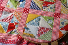 red, orange and recess fabrics | Flickr - Photo Sharing! The gingham and spot tie all the scraps together so well