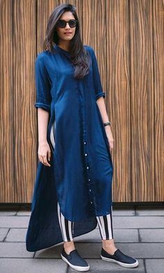 Wearing a dress over pants may seems unussual and not all women daring to wear it. Pakistani Dresses, Indian Dresses, Indian Outfits, Pakistani Clothing, Indian Sarees, Dress Over Jeans, Dresses With Leggings, Kurta Designs, Blouse Designs