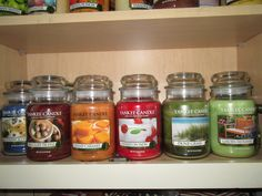 The bottom shelf of my Yankee Candle Cabinet