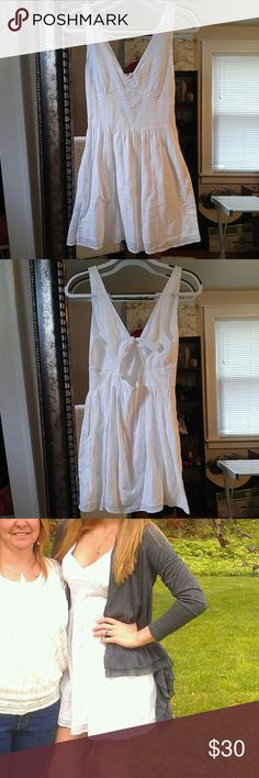 ⬇Price Drop!⬇White Tie Back V-Neck Sun Dress Price Drop! ⬇💸 Super cute white tie back sun dress. Light weight material for those hot days or nights. Cute (and handy) pockets! V-neck and peek back allows for a hint of sexy, or pair with a cardigan to dress it up.  Also available in black in my closet! Note: the other items in the photos are not included but the heels, earrings, bracelets and watch are all for sale in my closet! Dresses Mini