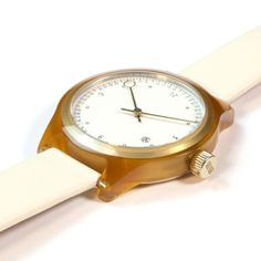 Minuteman Two Hand watch in honey with white leather strap by squarestreet. Available at Dezeenwatchstore.com #watches