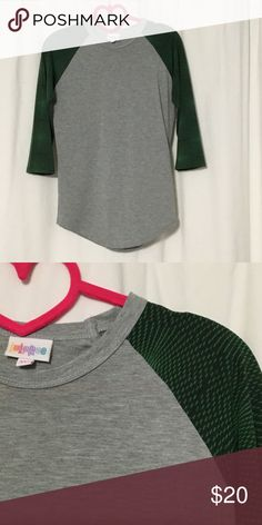 XXS Green sleeve LuLaRoe Randy (made in USA) Worn once - price FIRM - no trades - if you want a discount, purchase a bundle ❤ LuLaRoe Tops Tees - Short Sleeve
