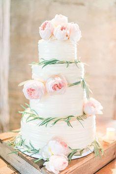 White wedding cake with flowers | Whimsical Romantic Wedding at Temecula Creek Inn | Southern California Bride