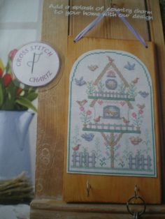 BIRDTABLE-BIRDS-FLOWERS-SAMPLER-BY-CATHY-BUSSI-CROSS-STITCH-CHART-ONLY
