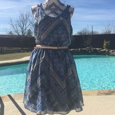 Ladies dress brand is By+By This pretty dress is so dainty with the crisscrossing back shows the back shoulders off is a size XLg. By + By Dresses Mini