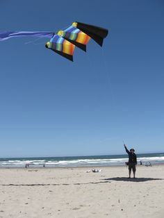 A large Power Sled kite being hand-flown in what must be a fairly light breeze. These things pull like horses in stronger wind! T.P. (my-best-kite.com)